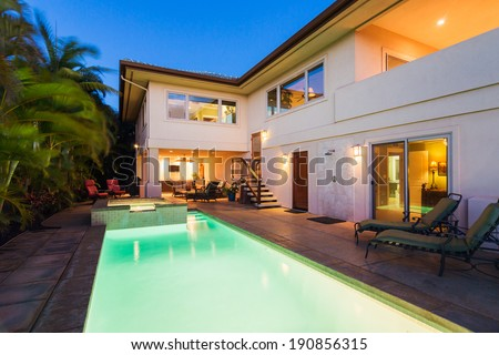 Luxury Home with Pool and Hot Tub at Sunset - stock photo
