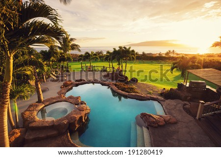 Luxury home with swimming pool at sunset, Tropical Villa Resort  - stock photo