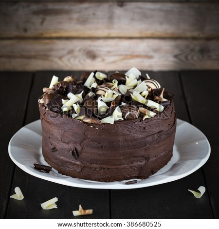 Luxury homemade chocolate cake on dark brown wooden table. - stock photo