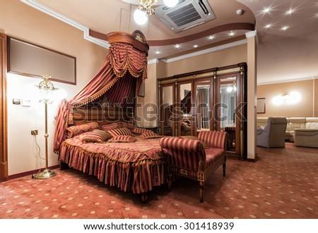 Luxury hotel bedroom interior - stock photo