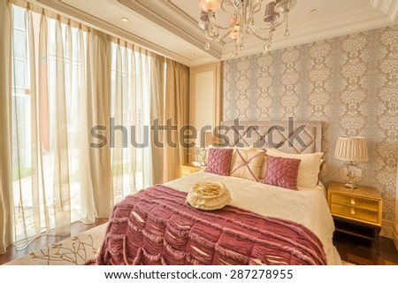 luxury hotel bedroom with upscale furniture and modern style decoration - stock photo