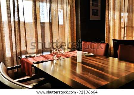 luxury hotel living room interior with brown furniture and large window - stock photo
