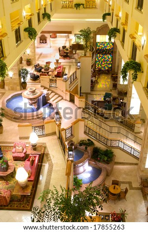luxury hotel lobby with fountains - stock photo