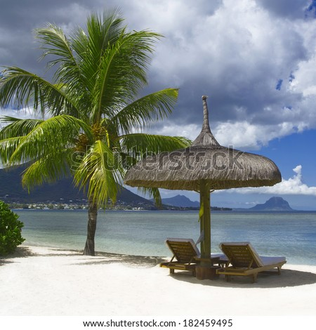 Luxury hotel on the tropical island. Sun, palm trees, warm water. Beautiful vacation spot, treatment and aquatics. - stock photo