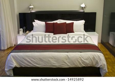 Luxury hotel room bed - stock photo