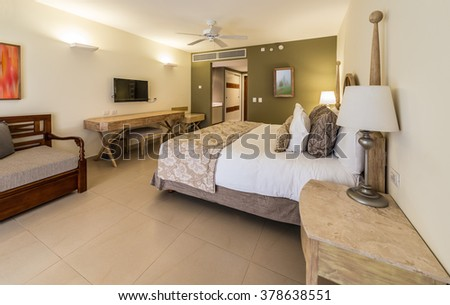 Luxury hotel room. Caribbean resort. Modern comfortable and elegant luxury master bedroom. Interior design.