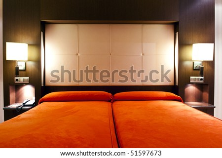 Luxury hotel room in red colors - stock photo