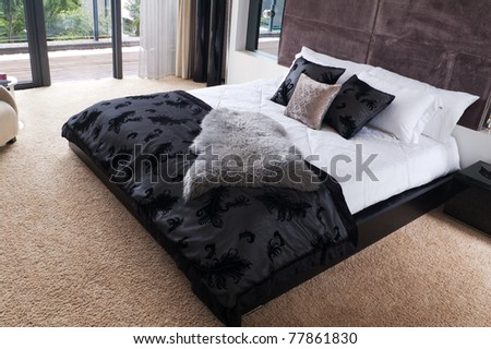Luxury hotel room interior with king-size bed - stock photo