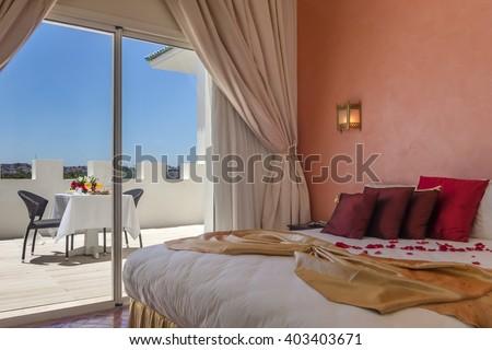 Luxury hotel room with breakfast on terrace - stock photo
