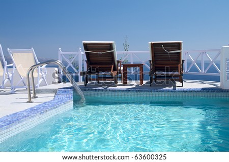 Luxury hotel swimming pool with sea view - stock photo