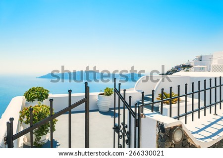 Luxury hotel with sea view. White architecture on Santorini island, Greece. Small depth of field - stock photo