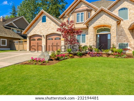 Luxury house against blue sky in Vancouver, Canada - stock photo