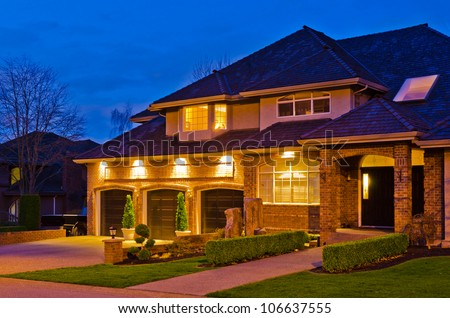 Luxury Home At Night Stock Photos Images Pictures Shutterstock