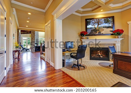 Luxury house interior. Office room with fireplace and hallway with shiny hardwood floor - stock photo