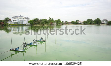 Luxury house on a lake electric water turbine machine