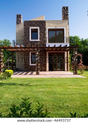 Luxury house on Greek coast - stock photo