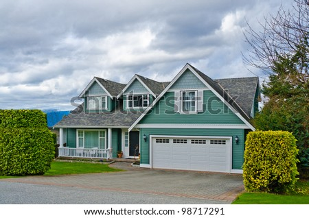 Luxury house over cloudy sky in Vancouver, Canada. - stock photo