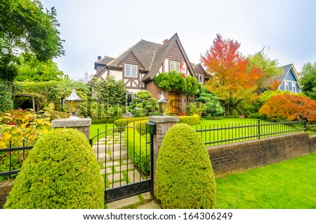 Luxury house with a red maple tree in Vancouver, Canada. - stock photo