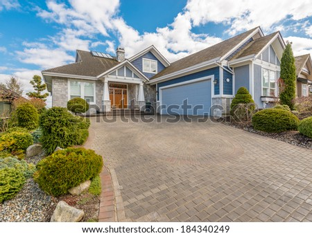 Luxury house with a two-car garage on a sunny day in Vancouver, Canada - stock photo