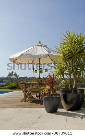 Luxury House with elegant outdoor patio - stock photo