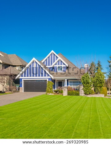 Luxury house with fantastic lawn at front yard in Vancouver, Canada.
