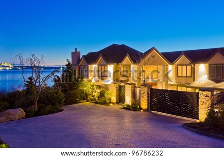 Luxury house with gorgeous night ocean view in Vancouver, Canada. - stock photo