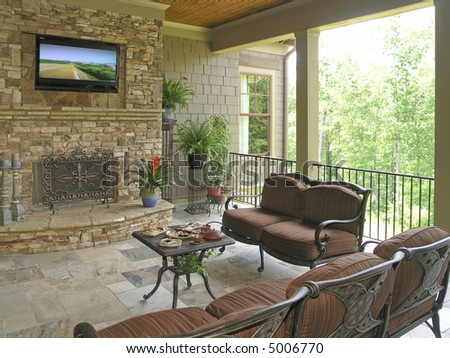 Luxury House with regal elegant covered outdoor patio - stock photo