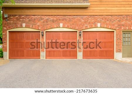 Luxury house with triple garage door in Vancouver, Canada. - stock photo