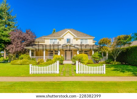 Luxury house with white gate in front in Vancouver, Canada. - stock photo
