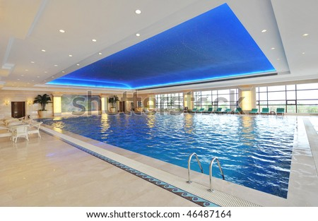 Luxury indoor swimming pool with beautiful clean blue water. - stock photo