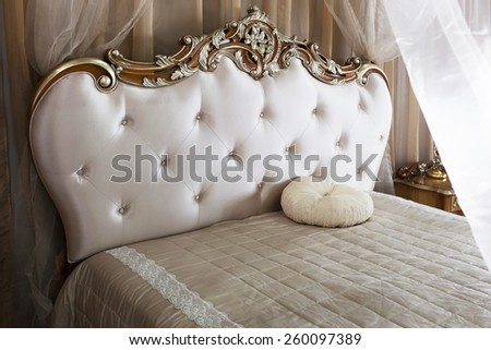 Luxury Interior.Antique Vintage Bed - stock photo