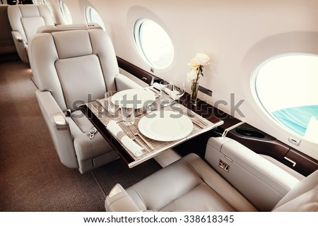 Luxury interior in bright colors of genuine leather in the business jet