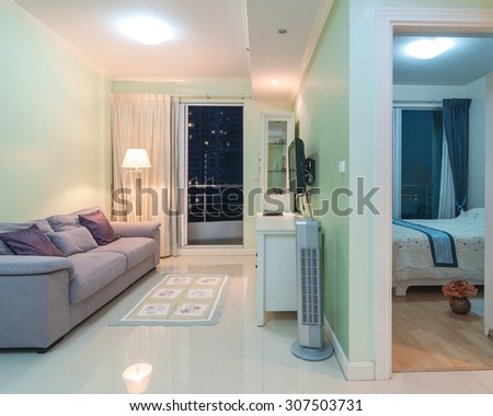 Luxury Interior living room and bedroom with blue sky at twilight time - stock photo