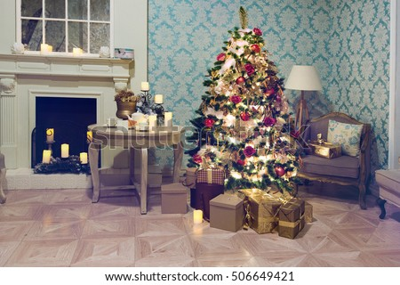 Luxury interior of living room with decorated Christmas tree and gifts on the wooden floor.