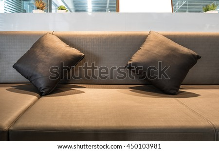 Luxury interior recreation room decorate pillows brown - stock photo