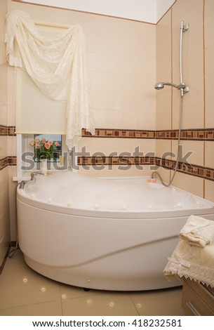 Luxury Jacuzzi with bubble bath, candles and flowers
