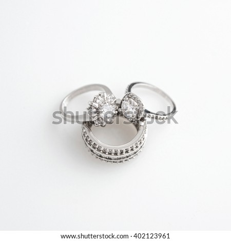 Luxury jewelry. White gold or silver rings with diamonds. Selective focus.