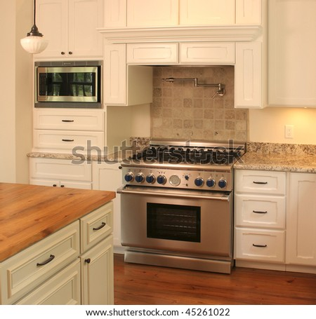 luxury kitchen detail on counter and stove - stock photo