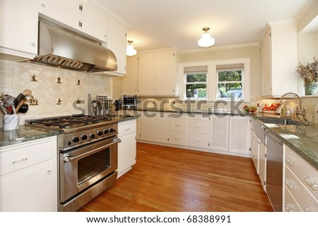 Luxury kitchen in a historical home. White cabinets and amazing details. - stock photo