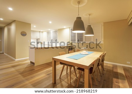 Luxury kitchen interior and dining area with wooden floors - stock photo