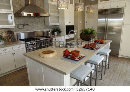 Luxury kitchen with a granite breakfast counter.