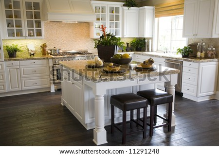 Luxury kitchen with a granite island. - stock photo