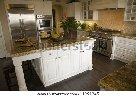 Luxury kitchen with a modern granite island. - stock photo