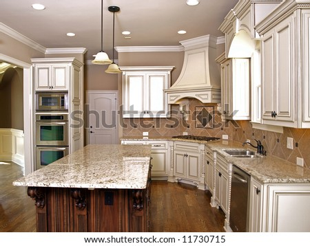 Luxury Kitchen with Granite topped Island - stock photo