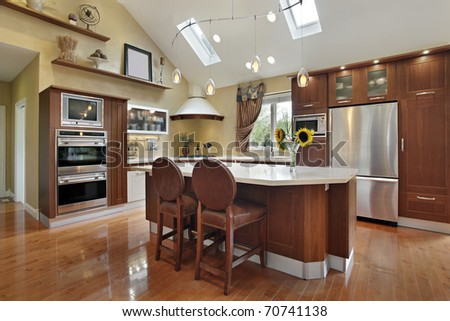Luxury kitchen with redwood cabinetry and center island - stock photo