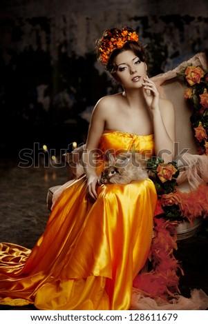 Luxury lady in silk dress with bunny - stock photo