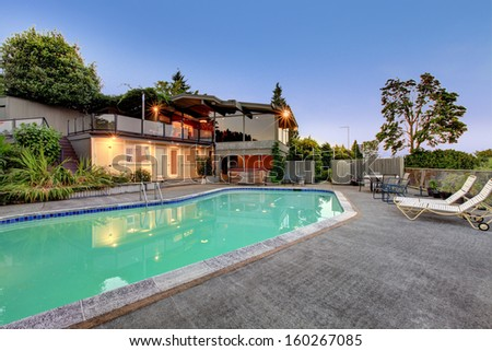 Luxury large home grounds with swimming pool. Summer Northwest evening. Lake Washington view. Very private fenced secluded back yard. - stock photo