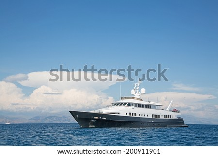 Luxury large super or mega motor yacht in the blue ocean. - stock photo