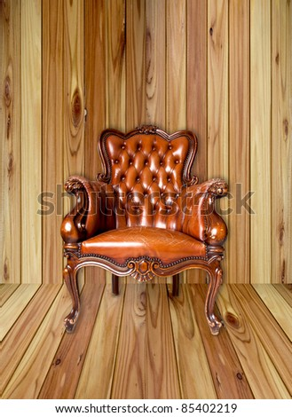 luxury leather armchair on wood - stock photo
