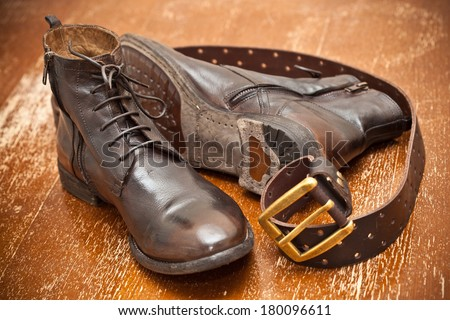 luxury leather shoes and a leather belt with buckle. cowboy style.